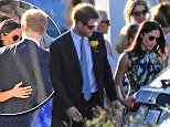 The couple were seen walking next to each other as they attended the ceremony in Montego Bay, on the north coast of Jamaica