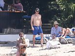 Prince Harry was spotted enjoying the Jamaican sun on the beach with friends after he and girlfriend Meghan Markle attending his friend's wedding