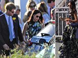 Fun in the sun: Harry in blue suit and sporting a yellow buttonhole, and Meghan in her £1,200 dress