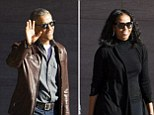 4284696 Not a care in the world? Barack and Michelle Obama smile for the cameras as they are seen for the first time since Trump's sensational phone tapping claims