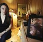 """In this Feb. 13, 2017 photo, Casey Anthony poses for a portrait next to a photo of her daughter, Caylee, in her West Palm Beach, Fla., bedroom. In an exclusive interview with The Associated Press, Anthony claims the last time she saw Caylee she """"believed that she was alive and that she was going to be OK."""" (AP Photo/Joshua Replogle)"""