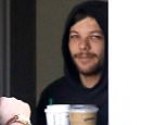 Tomlinson was booked for simple battery on Friday night after he became enraged by paparazzi taking pictures of him and girlfriend Eleanor Calder