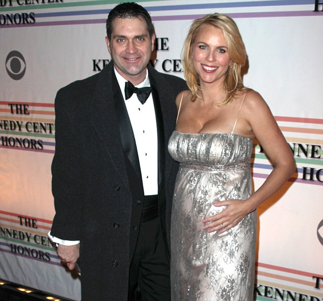 Married couple: Miss Logan, pictured when she was pregnant, with her husband Joseph Burkett, whom she met while they were both working in Iraq