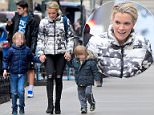 Out and about: Megyn Kelly was photographed shopping with her two sons Edward and Thatcher on Monday (above)