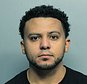 In this photo made available by the Miami Beach Police Dept., Fla., shows Evan Zavier Little under arrest Sunday, March 5, 2017. Authorities say Little raped and beat his girlfriend for nearly two weeks because she lost a purse he bought her. (Miami Beach Police Dept. via AP)
