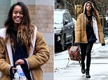 Malia Obama donned her favorite Alexander Wang jacket to walk to work in the rain on Tuesday