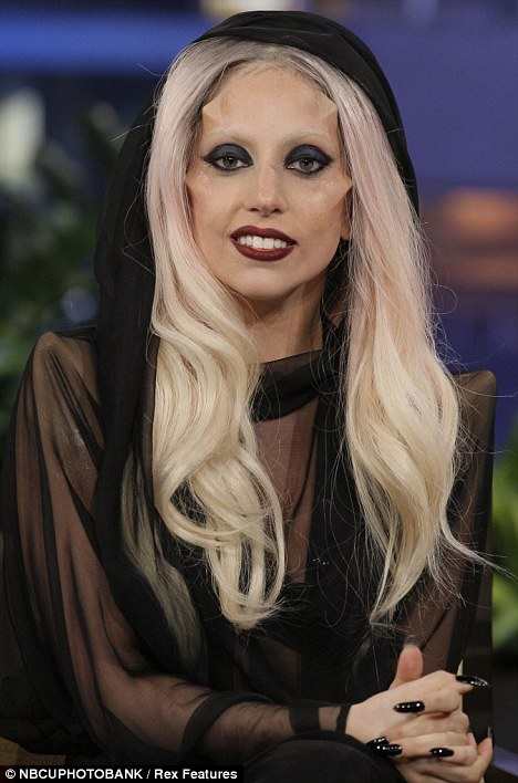 Spot the difference: It made Gaga, left, look like robot Kryten, fAll angles: Lady Gaga was sporting facial furniture to make it look like she'd had subdermal implants on Jay Leno's U.S chat show