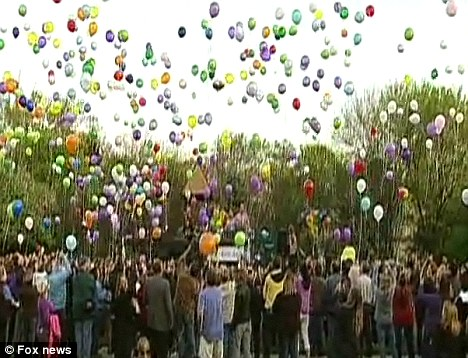 Remembered: Family and friends release balloons at a 15th birthday part for Kelli O'Laughlin, who was stabbed to death by a burglar in October