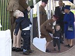 The Queen had to wait patiently for toddler Alfie Lunn as he did his best to squirm out of handing over a posy at the unveiling of a new war memorial in central London today