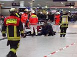 Pictured: Paramedics rush to the aid of a victim of the train station attack in Dusseldorf