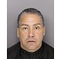 This March 3, 2017 photo provided by Greenville, S.C., police shows Michael Ruiz in Greenville after his arrest on human trafficking charges, including posing as an ICE agent and swindling immigrants out of more than $70,000. Ruiz is among the con artists across the country are taking advantage of a climate of fear among immigrants by posing as federal agents and ordering them pay up or else be detained and deported, authorities and outreach groups say. (Greenville, SC Police Dept. via AP)