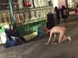 A naked man has been filmed crawling on all fours towards a homeless personoutside London's Tottenham Court Road station at around 9pm on Wednesday