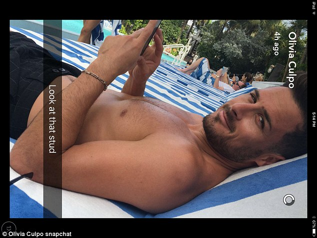 Lying around: 'Look at that stud,' Olivia captioned a Snapchat photo of her handsome beau reclining on a sunbed