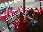 The video shows a man enjoying a drink in a bar with two women - before his angry wife storms in from the right