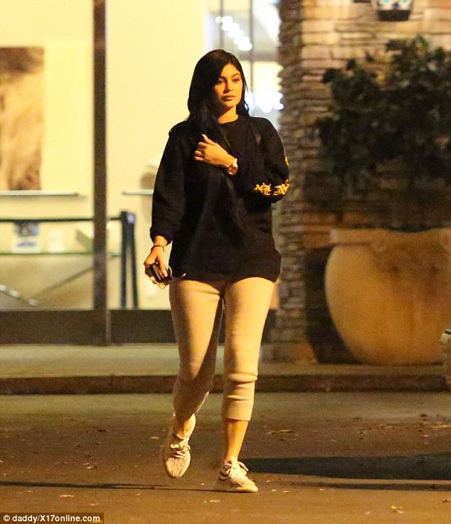 Casual: Kylie was more covered up in leggings and an oversized black hoodie