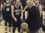 Jaylen Levy, three, went to hug his older sister Sydney after her high school basketball game on Saturday but was blocked by tournament organizer Deb Hauser (right)