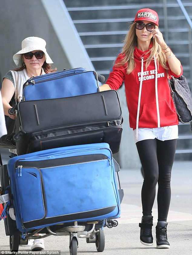 West coast trip: Miami-based Joanna Krupa was spotted at LAX on Monday along with her mother and several large suitcases