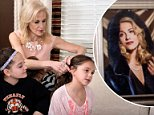 Kellyanne Conway, pictured playing with her daughter Charlotte's hair, was interviewed in her Alpine, New Jersey home. She discussed surveillance and other matters but what intrigued Twitter was a photo of her wearing a velvet cloak
