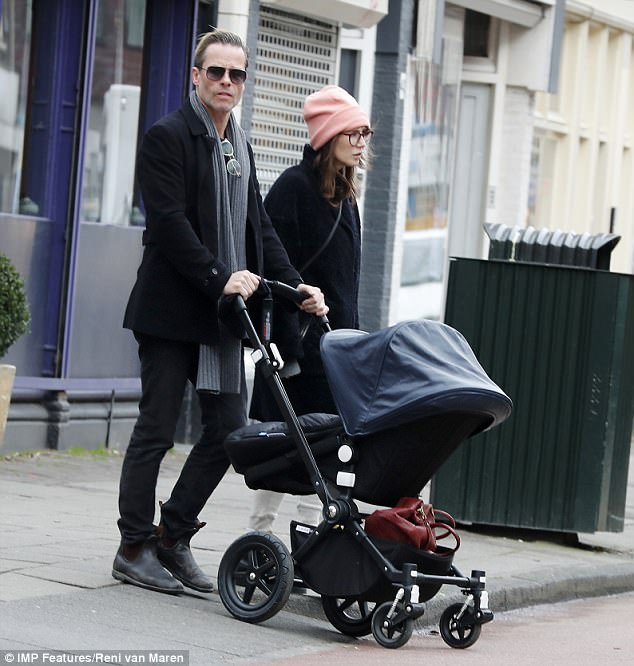 Proud parents: Guy Pearce and his partner Caricevan Houten stepped out in Amsterdam with their son Monte