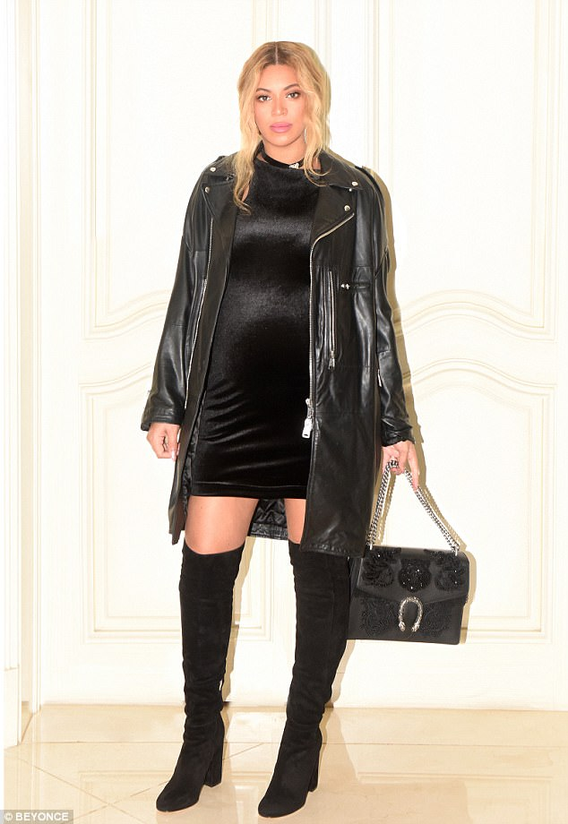 Outerwear: The star's look was complete with a leather coat and embellished purse