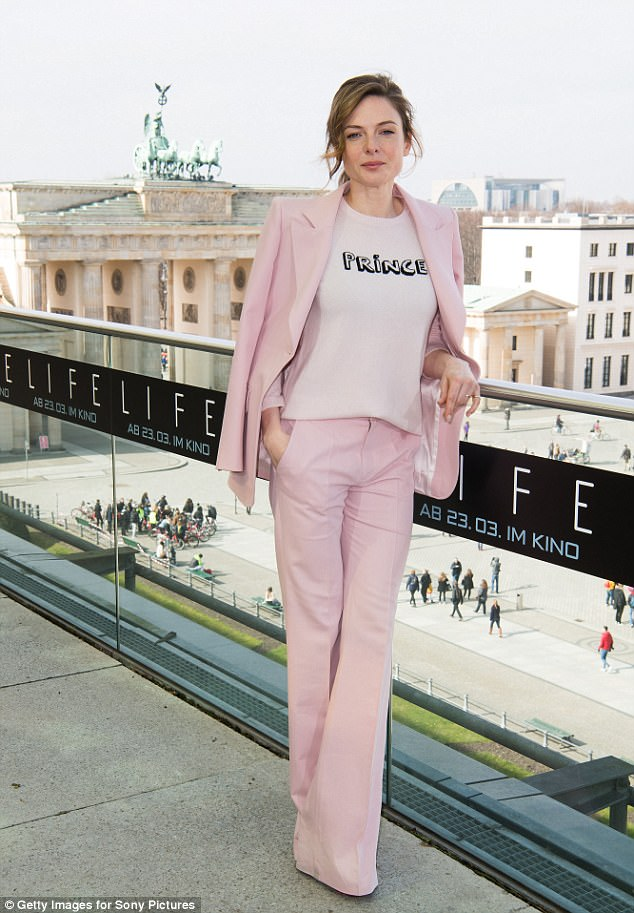 Pretty in pink: Swedish beauty Rebecca stunned in a light pink suit which she wore with a simple 'Prince' T-shirt