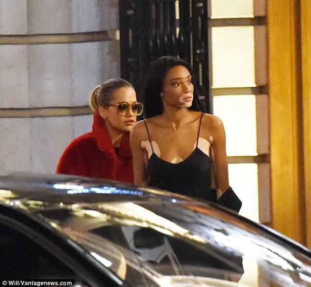 Cosy:Whilst she kept a neutral expression, the Hot Right Now singer was inseparable from Winnie - who is said to be dating Lewis currently