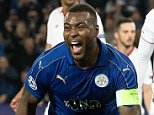 Leicester captain Wes Morgan roars in celebration after giving his side the advantage on the night and in the tie