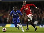 N'Golo Kante (left) gives Paul Pogba the runaround as Chelsea beat Manchester United