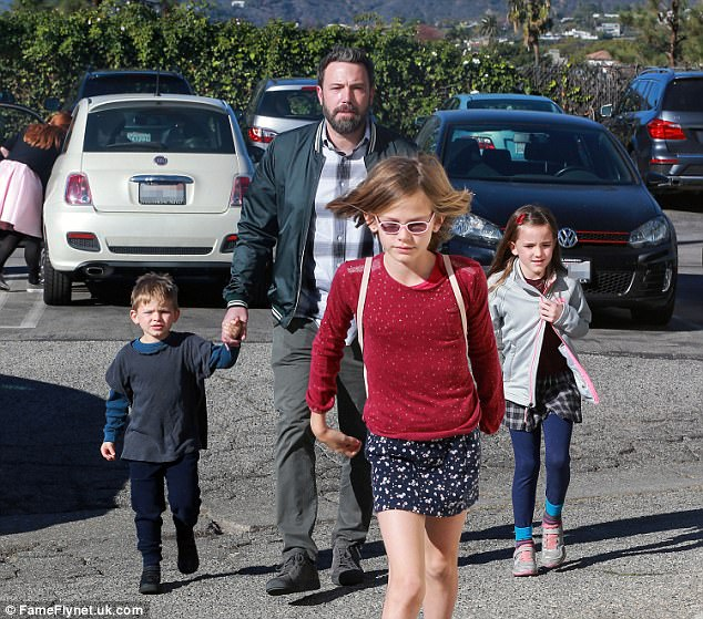 Focusing on fatherhood: The actor, 44, whose own father was an alcoholic, said he was motivated to seek treatment so he could be 'the best father I can be' to his three children, Samuel, five, Violet, 11, and Seraphina, eight, pictured with him in December