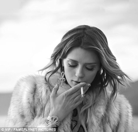 Counter: Mischa switched from healthy water to less healthy cigarettes for a few black and white snaps