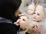 Heads of love dolls are seen on the shelf inside Japan's oldest 'love doll' maker Orient Industry