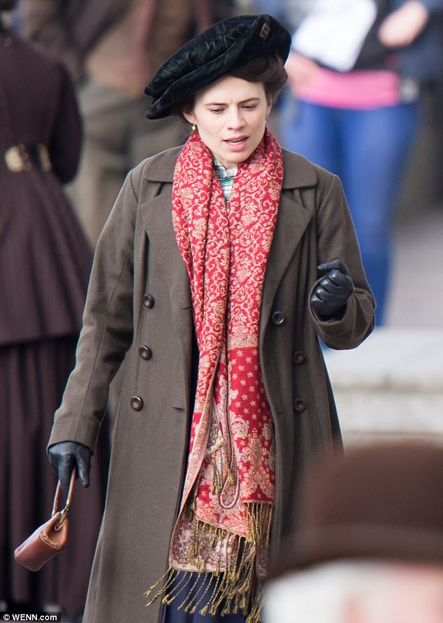 Apt attire: Hayley was appropriately dressed the era, stepping before cameras in a full-length brown coat, teamed with a red patterned scarf and flowing blue skirt