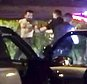 """This March 12, 2017, image made from a video provided by Clay Connell shows a confrontation between Orange, Calif., police officers and a shirtless man during a traffic-stop-turned-standoff. A video obtained Thursday, March 16, by The Associated Press shows Michael Perez exit the driver's side window of a minivan after police broke windows and used the hose to end a standoff late Sunday. Police scream """"knife"""" seconds before the Perez is fatally shot. (Clay Connell via AP)"""