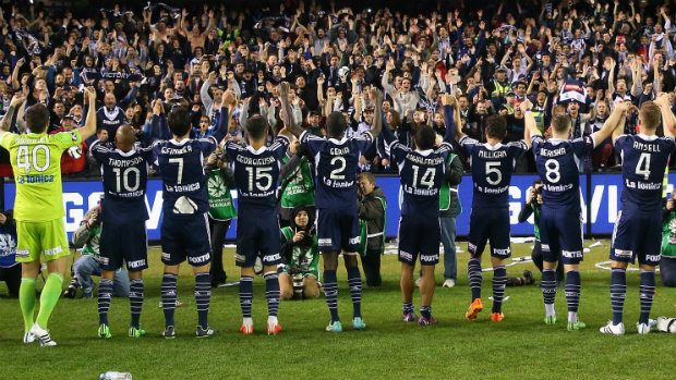 Melbourne Victory players celebrate their win at Etihad Stadium at full-time.