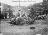 Shocking pictures show how so-called 'human zoos' around the world kept 'primitive natives' in enclosures so Westerners could gawp and jeer at them. Filipinos are pictured in loin cloths sitting in a circle together at Coney Island in New York in the early 20th century while crowds of white Americans watch on from behind barriers