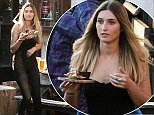 The topless model who partied with Prince William in Verbier is back at her day job serving food and drinks in a luxury hotel bar