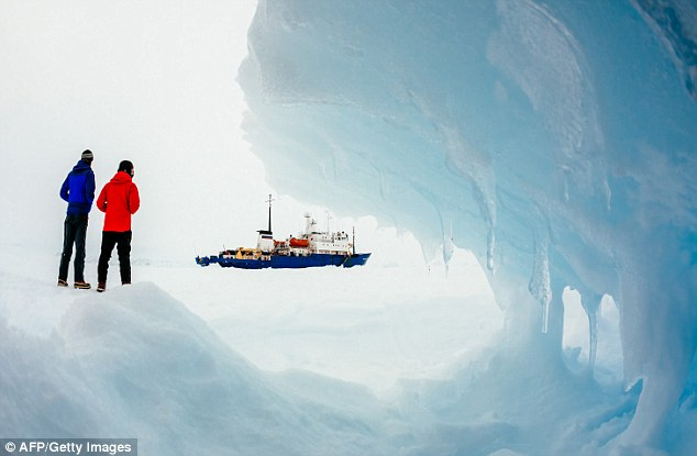 This image, taken by passenger Andrew Peacock, shows the ship still stuck in the ice off East Antarctica, as it waits to be rescued