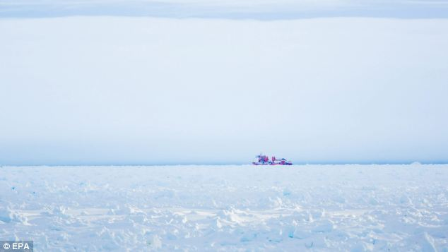 Failed: This picture, tweeted by passenger Chris Turney, shows the top-of-the-range icebreaker, China's 'Snow Dragon' which also got stuck and was forced to retreat on Friday
