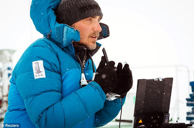 Professor Chris Turney, leader of the Australasian Antarctic Expedition, is pictured talking to international media from the top deck of the stranded ship