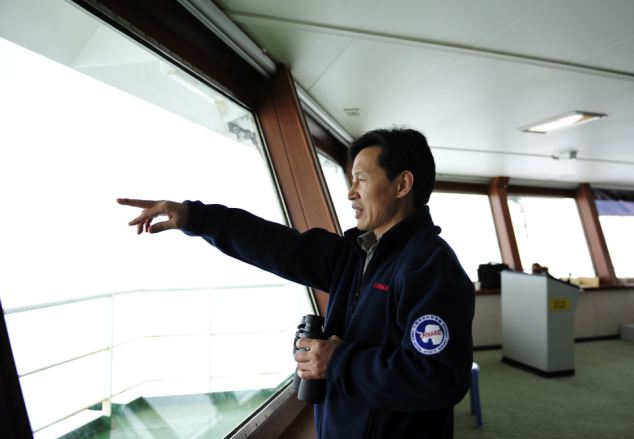 However just before midnight on Friday Captain Wang Jianzhong's ship (pictured) also became trapped