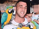 Deception: Astbury posed  parrots on an exotic break while claiming he was unfit for work