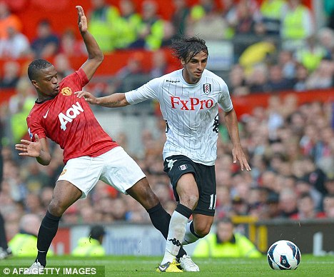 Battle for position: Bryan Ruiz (right) will hope to start for the Cottagers