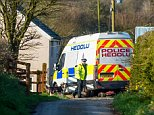 Police officers on guard near the home ofKhalid Masood's mother in the village of Trelech, Carmarthenshire, Wales
