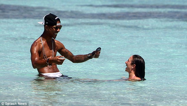 Fun in the sun: Tulisa squealed with laughter as she and her bandmate-turned-boyfriend splashed about in the water