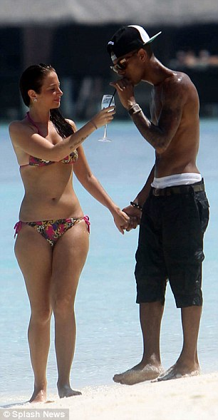 The look of love: Fazer took a sip of Tulisa's drink before wrapping his arms appreciatively around his girlfriend