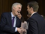 In this March 21, 2017 photo, Supreme Court Justice nominee Neil Gorsuch, left, shares a laugh with Senate Judiciary Committee member Sen. Ben Sasse, R-Neb.as he arrives on Capitol Hill in Washington, for his confirmation hearing before the Senate Judiciary Committee. Former New Hampshire Sen. Kelly Ayotte is at center. (AP Photo/Susan Walsh)
