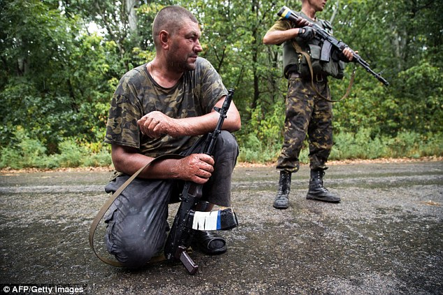 Mercy: In a statement issued through the Kremlin today, Russian president Putin told the separatists to open up a 'humanitarian corridor' through which to release trapped enemy troops to 'avoid senseless deaths'