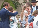 NRL star Brett Kimmorley comforting his daughters as they farewell the devoted mother-of-four on Thursday