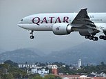 A Qatar Airways plane approaches Los Angeles International Airport on March 21, 2017