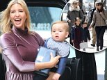 Ivanka Trump looks stunning in a mauve dress as she leaves her New York home with two of her children. Seen above with Theodore